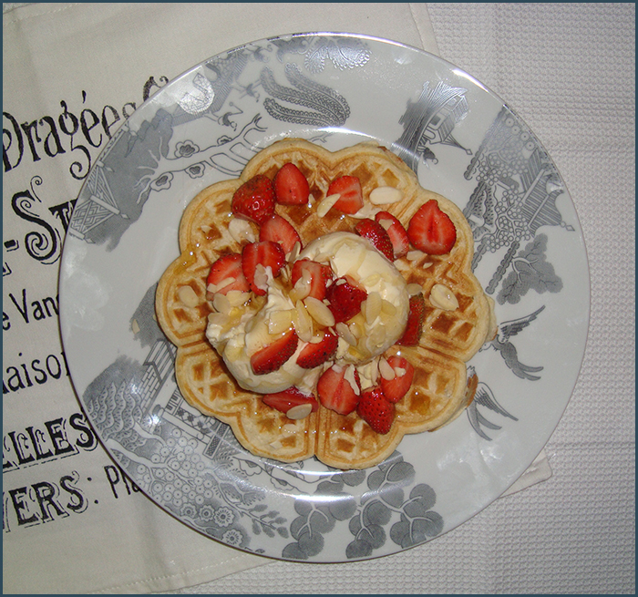 honey-drizzled-waffles-with-vanilla-ice-cream-strawberries-and-almonds-3